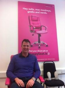 Gary Mullan, in the Pink Happy Seat in the Prosperity office