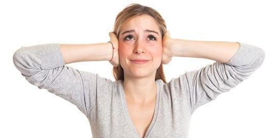 noisy-neighbour-woman-hands-on-head
