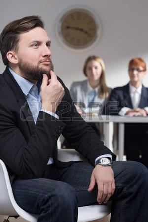 59136014-shot-of-a-thoughtful-businessman-and-his-colleagues-in-a-background