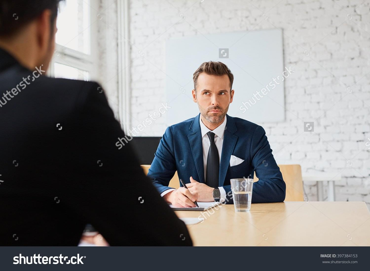 stock-photo-job-interview-businessman-listen-to-candidate-answers-397384153